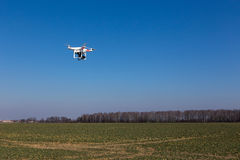 Small drone. Is flying with the blue sky in the background stock photos