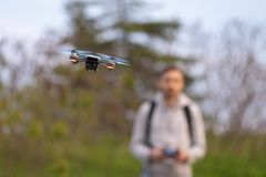 Young man navigates small drone. stock photos