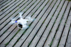 The small drone flying over the field Stock Photography