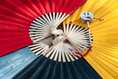 Small drum on colorful paper fans background Royalty Free Stock Photos