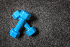 Small dumbbells on floor. Royalty Free Stock Images