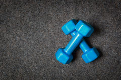 Small dumbbells on floor. Stock Photo