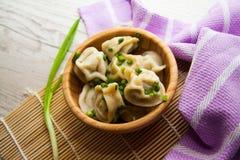 Small dumplings in bowl Stock Images
