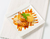 Small Dutch cakes with ice cream and drizzle sauce Stock Photo