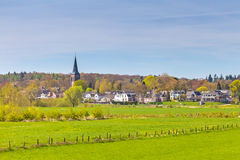 The small Dutch village of Dieren in front of the Veluwe Stock Photos