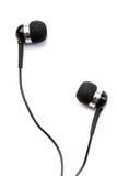 Small in-ear headphones Royalty Free Stock Photos