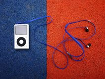 Small earphones-plugs. Details and close-up. Bright light stock images