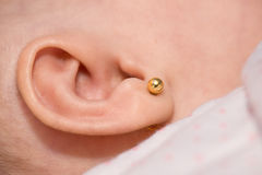 Small earring Royalty Free Stock Image