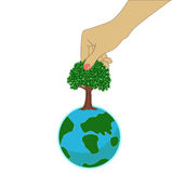 Small earth with tree and hand Stock Image