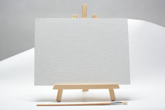 Small easel. On a white paper stock photos
