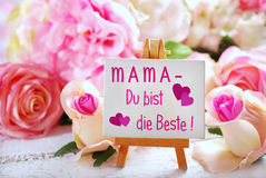Small easel with greetings for mom written in german on the boar Royalty Free Stock Photography