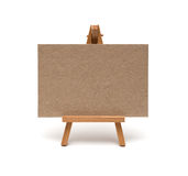 Small easel with sheet of paper Royalty Free Stock Photo