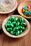 Small easter eggs in bowl. Small Easter eggs wrapped in aluminum foil Stock Image