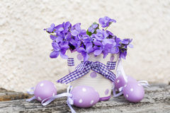 Small  easter eggs and vase with  violets Stock Images