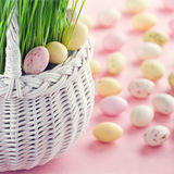 Small easter eggs in a white basket Stock Photo