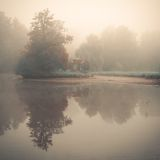 Small eastern arbour on a lake island in fog. Small eastern arbour on a lake island in a foggy morning Stock Images