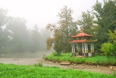 Small eastern arbour. On a lake island in a foggy morning Stock Images