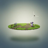 Small eco world. A small grassed levitating surface with animals and small house with wimdmill (as a symbol of renewable energy Royalty Free Stock Photos