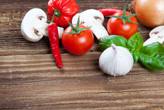 Small edge of vegetables and herbs on old wood Stock Photo