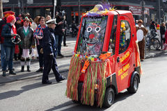 A small electric car at a carnival procession stock photos
