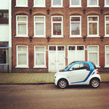 Small electric car on street. Small electric car parked on a street in Amsterdam, Holland Royalty Free Stock Photo