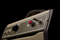 Small electric guitar amplifier. Close up of a small electric guitar amplifier on dark background Vector Illustration
