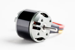 Small electric motor on white. Background royalty free stock photo