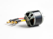 Small electric motor and wires on white Royalty Free Stock Image