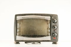Small electric oven. Isolated in the kitchen royalty free stock photography