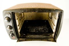 Small electric oven. Isolated in the kitchen royalty free stock image
