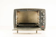 Small electric oven. Isolated in the kitchen stock photos