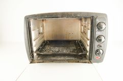 Small electric oven. Isolated in the kitchen stock images