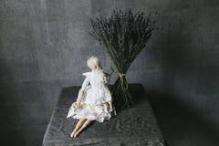 Small elegant handmade doll close up stock image