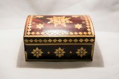 Small casket for valuables. Small elegant retro casket for storing valuables and jewelry Stock Photos