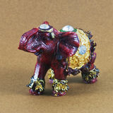Small elephant model. With reflection on beige background Royalty Free Stock Photos