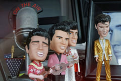 Small Elvis characters in a Memphis store. MEMPHIS, TENNESSEE, May 11, 2015 : Small Elvis characters and a mike. Regarded as one of the most significant cultural royalty free stock images