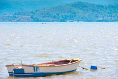 Small empty boat on the muddy water Royalty Free Stock Image