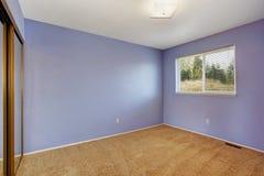 Small empty bright room in lavender color Stock Photos