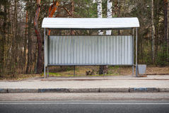 Small empty bus stop building on the roadside Royalty Free Stock Photography
