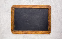 Small empty chalkboard. On a light grey textured background. Blank. Blackboard Background. Blackboard texture stock image