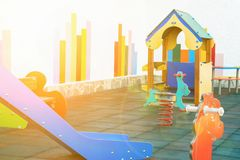 Small Empty Children Playground of a Kindergarten in a European City. Colorful Wooden House Seesaw Slide Soft Rubber Ground. Outdoors Summer Golden Sunlight Stock Photo