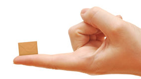 Small empty envelope on woman's finger Royalty Free Stock Photos