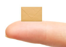 Small empty envelope on woman's finger Royalty Free Stock Image