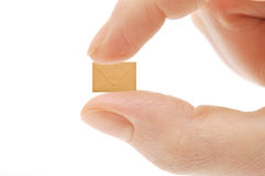 Small empty envelope on woman's finger Stock Photography