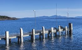 Small empty mooring pier with bumpers, Norway Royalty Free Stock Image