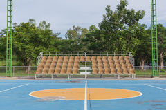 Small empty old brown grandstand Stock Image