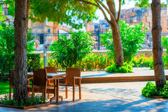 Small empty restaurant among the trees Royalty Free Stock Images