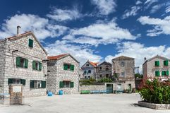 Åepurine - picturesque mediterranean village on Prvic island, Adriatic Coast, Croatia. Small, empty square surrounded by old, stone built houses of historic royalty free stock photo