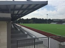 Small empty stadium with bleacher for amateur sports events. Photo of small empty with bleacher stadium for amateur sports events. It can use for motivation stock photo
