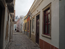 Small empty street with flaking colour houses in Naples royalty free stock images
